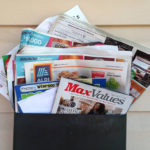 Junk mail overflowing from mail box